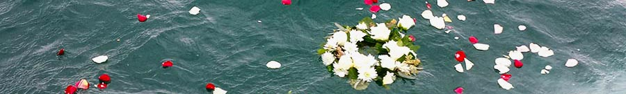 Placing flowers and wreaths in the water is common during a burial at sea - ash scattering